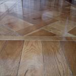 foto parquet listoni in legno massello effetto sovrapposto